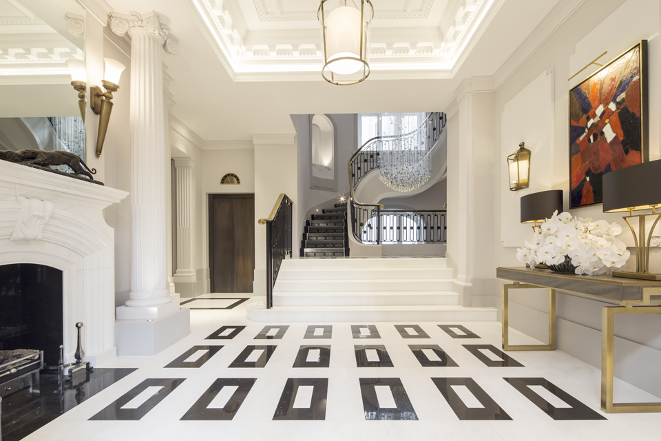 waltonwagner, Cleveland Court in St James's London. The development is characterised by the reinstated historic reception. With a British limestone floor, 4-storey Sharon Marston glass chandelier, and refurbished original staircase with restored metal balustrade and bronze handrail.