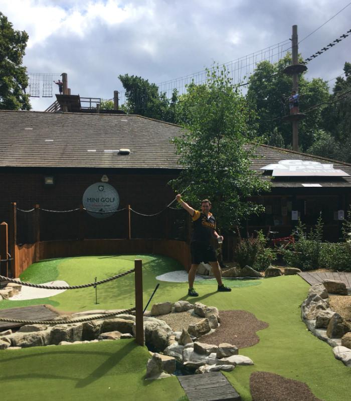 Luke Harding playing golf